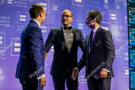 President of the Human Rights Campaign Chad Griffin (center) joins the stage with Democratic presidential candidate Pete Buttigieg and husband Chasten Glezman Buttigieg during the Human Rights Campaign's 14th annual Las Vegas Gala at Caesars Palace on