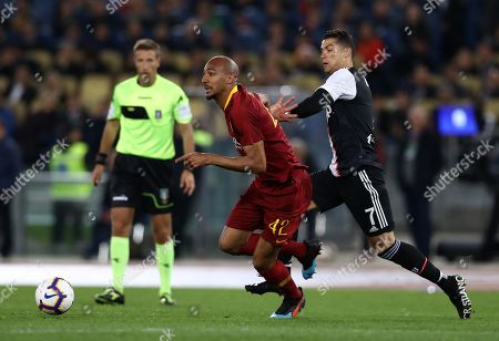 Cristiano Ronaldo of Juventus and Steven Nzonzi of Roma