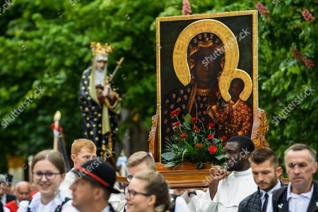 Stock Photo of Members of the Polish catholic church seen carrying the Black Madonna of Czestochowa painting during the Procession