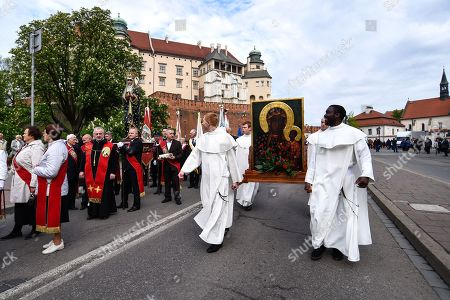Members of the Polish catholic church seen carrying the Black Madonna of Czestochowa painting during the Procession