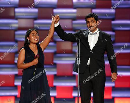 Yalitza Aparicio (L) and actor Tenoch Huerta gesture on stage during the sixth edition of the Platino Awards at the Xcaret Park in Playa del Carmen, Riviera Maya, Mexico, 12 May 2019.