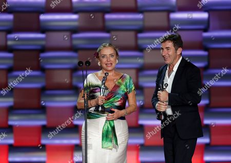 Actor Ana Braun (L) stands with her award for the Best Actress for her performanc in the film 'Las Herederas', next to actor Antonio de la Torre (R), who stands with his award for Best Actor for his performance in the film El Reino, during the sixth edition of the Platino Awards at the Xcaret Park in Playa del Carmen, Riviera Maya, Mexico, 12 May 2019.