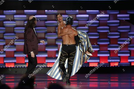 Cecilia Suarez (C, back) is carried away as host Santiago Segura (L) looks on during the sixth edition of the Platino Awards at the Xcaret Park in Playa del Carmen, Riviera Maya, Mexico, 12 May 2019.
