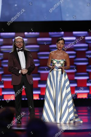 Stock Image of Cecilia Suarez (R) and host Santiago Segura (L) speak during the sixth edition of the Platino Awards at the Xcaret Park in Playa del Carmen, Riviera Maya, Mexico, 12 May 2019.