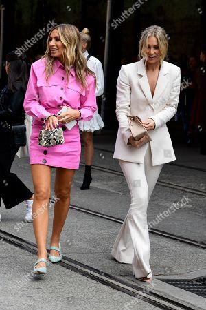 Influencers Nadia Bartel (R) and Anna Heinrich (L) walk between venues during Mercedes-Benz Fashion Week Australia in Sydney, Australia, 13 May 2019.