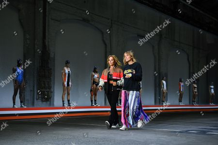 Stock Image of P.E Nation designers Pip Edwards (C-L) and Claire Tregoning (C-R) walk the runway following their show during Mercedes-Benz Fashion Week Australia in Sydney, Australia, 13 May 2019.