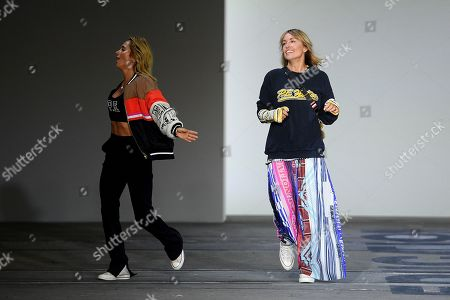 P.E Nation designers Pip Edwards (L) and Claire Tregoning (R) gesture following their show during Mercedes-Benz Fashion Week Australia in Sydney, Australia, 13 May 2019.