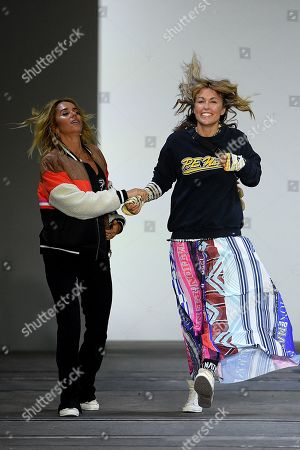 Stock Photo of P.E Nation designers Pip Edwards (L) and Claire Tregoning (R) gesture following their show during Mercedes-Benz Fashion Week Australia in Sydney, Australia, 13 May 2019.