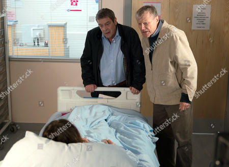 Ep 9770 Wednesday 15th May 2019 - 1st Ep Carla Connor, as played by Alison King, wakes to find Johnny Connor, as played by Richard Hawley, and Roy Cropper, as played by David Neilson, at her hospital bedside and freaks out.