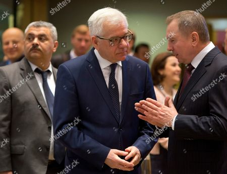 Belarus' Foreign Minister Vladimir Makei, right, speaks with Polish Foreign Minister Jacek Czaputowicz during a round table meeting of EU foreign ministers and Eastern Partnership nations at the Europa building