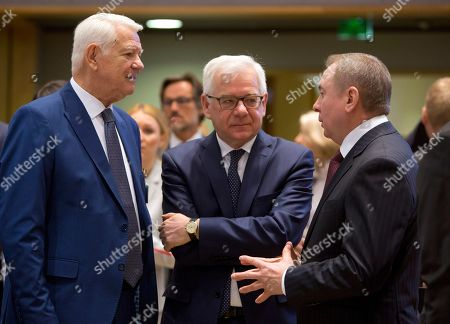 Stock Image of Belarus' Foreign Minister Vladimir Makei, right, speaks with Romanian Foreign Minister Teodor-Viorel Melescanu, left, and Polish Foreign Minister Jacek Czaputowicz during a round table meeting of EU foreign ministers and Eastern Partnership nations at the Europa building