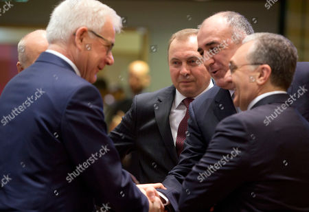 Azerbaijan's Foreign Minister Elmar Mammadyarov, second right, shakes hands with Polish Foreign Minister Jacek Czaputowicz, left, as Belarus Foreign Minister Vladimir Makei, center, looks on during a round table meeting of EU foreign ministers and Eastern Partnership nations at the Europa building