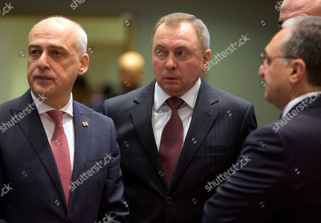 Belarus Foreign Minister Vladimir Makei, center, waits for the start of a round table meeting of EU foreign ministers and Eastern Partnership nations at the Europa building