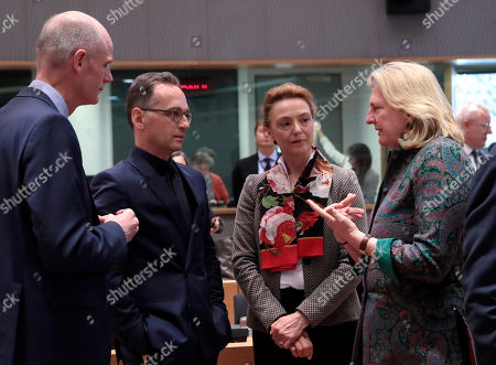 Austrian Foreign Minister Karin Kneissl, right, speaks with from left, Dutch Foreign Minister Stef Blok, German Foreign Minister Heiko Maas and Croatian Foreign Minister Marija Pejcinovic Buric during a round table meeting of EU foreign ministers and Eastern Partnership nations at the Europa building