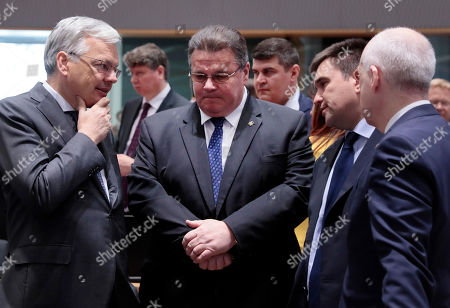 Belgian Foreign Minister Didier Reynders, left, speaks with Lithuanian Foreign Minister Linas Linkevicius, center, and Ukraine's Foreign Minister Pavlo Klimkin, second right, during a round table meeting of EU foreign ministers and Eastern Partnership nations at the Europa building