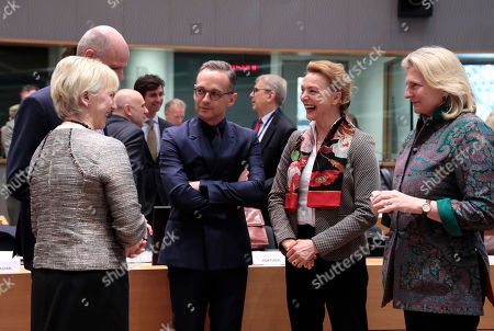 German Foreign Minister Heiko Maas, center, speaks with from left, Swedish Foreign Minister Margot Wallstrom, Dutch Foreign Minister Stef Blok, Croatian Foreign Minister Marija Pejcinovic Buric and Austrian Foreign Minister Karin Kneissl during a round table meeting of EU foreign ministers and Eastern Partnership nations at the Europa building