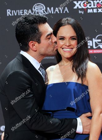 Stock Photo of Omar Chaparro (L) kisses his wife Lucia Ruiz (R) as they arrive for the sixth Platino Awards ceremony at the Xcaret park in Playa del Carmen, Riviera Maya, Mexico, 12 May 2019 (issued 13 May 2019).