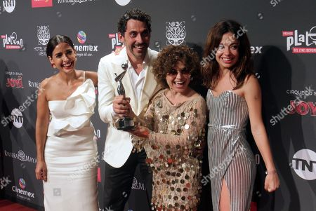 Paco Leon (2-L) and actresses Inma Cuesta (L), Anna R. Costa (2-R) and Anna Castillo (R) pose with the Platino Award for the Best Miniseries for 'Arde Madrid' during the sixth Platino Awards ceremony at the Xcaret park in Playa del Carmen, Riviera Maya, Mexico, 12 May 2019 (issued 13 May 2019).