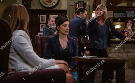 Ep 8489 Tuesday 28th May 2019 In the Woolpack, Megan Macey, as played by Gaynor Faye, breaks down to Manpreet, as played by Rebecca Sarker, just as Kim Tate, as played by Claire King, arrives and tells her she should face the consequences of her actions in front of the whole pub. Megan feels utterly hated.