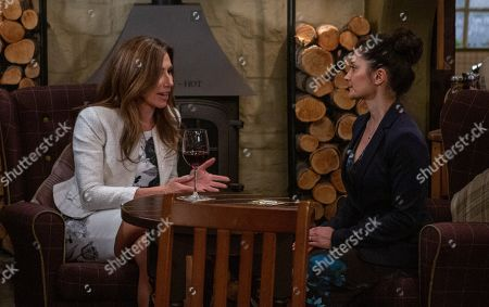 Ep 8489 Tuesday 28th May 2019 In the Woolpack, Megan Macey, as played by Gaynor Faye, breaks down to Manpreet, as played by Rebecca Sarker, just as Kim Tate arrives and tells her she should face the consequences of her actions in front of the whole pub. Megan feels utterly hated.