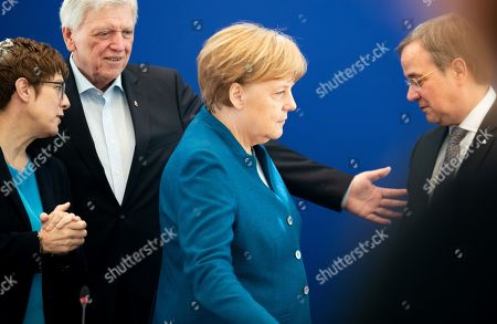 (L-R) Christian Democratic Union (CDU) party chairwoman Annegret Kramp-Karrenbauer, Premier of Hesse Volker Bouffier, German Chancellor Angela Merkel and Premier of North Rhine-Westphalia Armin Laschet talk at the beginning of a board meeting at the CDU headquarters in Berlin, Germany, 13 May 2019.