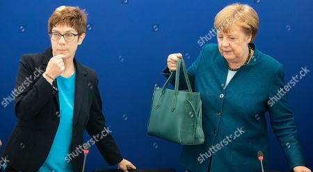 (L-R) Christian Democratic Union (CDU) party chairwoman Annegret Kramp-Karrenbauer, Premier of Hesse Volker Bouffier and German Chancellor Angela Merkel talk at the beginning of a board meeting at the CDU headquarters in Berlin, Germany, 13 May 2019.