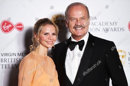 Kelsey Grammer (R) and Kayte Walsh (L) in the press room at the Virgin Media British Academy Television Awards at the Royal Festival Hall in London, Britain, 12 May 2019. The ceremony is hosted by the British Academy of Film and Television Arts (BAFTA).