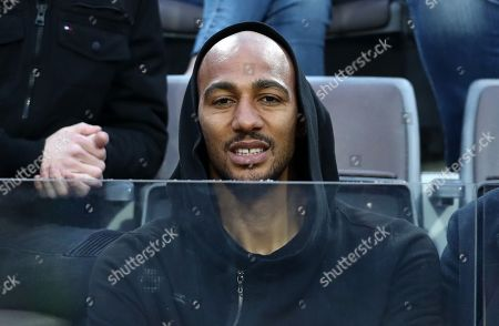 As Roma football player Steven Nzonzi watches the match
