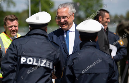 Bavarian Minister of the Interior, Joachim Herrmann, arrives for a visit at a police checkpoint at the Motorway A9 (Autobahn 9) in Fahrenzhausen near Munich, Bavaria, Germany, 13 May 2019.