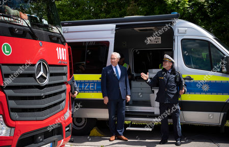 Bavarian Minister of the Interior, Joachim Herrmann (L), visits at a police checkpoint at the Motorway A9 (Autobahn 9) in Fahrenzhausen near Munich, Bavaria, Germany, 13 May 2019.