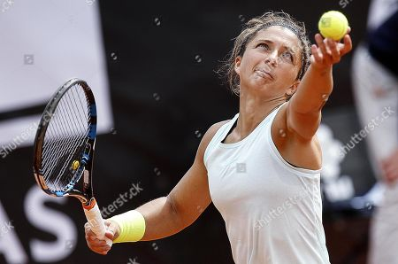 Stock Photo of Sara Errani of Italy in action against Viktoria Kuzmova of Slovakia during their women's singles first round match at the Italian Open tennis tournament in Rome, Italy, 13 May 2019.