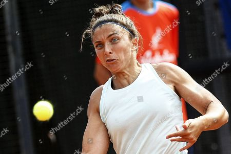 Stock Image of Sara Errani of Italy in action against Viktoria Kuzmova of Slovakia during their women's singles first round match at the Italian Open tennis tournament in Rome, Italy, 13 May 2019.