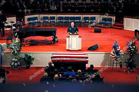 Stock Picture of Speaking before the family of officer Robert S. McKeithen, Chief of Police John Miller, tells of the special relationship McKeithen had with the city and the county during his funeral in the First Baptist Church of Biloxi, . McKeithen was killed outside headquarters May 5