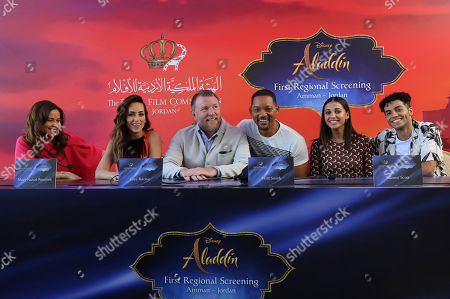 "Will Smith, Guy Ritchie, Naomi Scott, Mena Massoud, Raya Abirached. Actor Will Smith, second right, director Guy Ritchie, left, and cast members Naomi Scott, second right, and Mena Massoud, give a news conference for the regional launching of Disney's live-action ""Aladdin,"" in the Jordanian capital Amman, . The film opens in Middle East theaters May 23. Raya Abirached, left, and Mary Nazzal-Batayneh, second left, also attended"