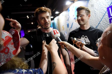 Sebastian Rejman, Ville Virtanen aka Ville Virtanen, the Finnish entry for Eurovision 2019, surrounded by the press after the first semi-final dress rehearsal