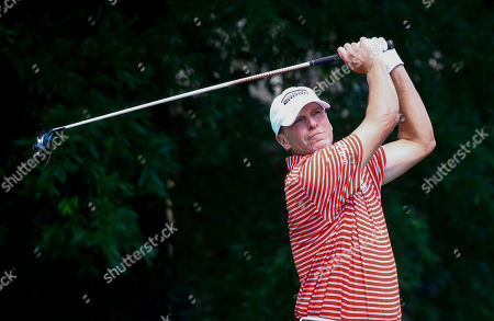 Steve Stricker tees off on the ninth hole during the final round of the Regions Tradition Champions Tour golf tournament, in Birmingham, Ala