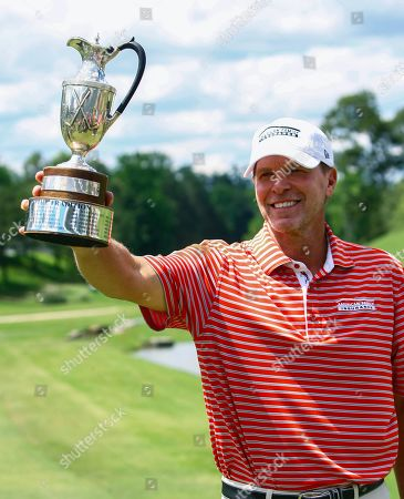 Steve Stricker holds up the trophy after winning the Regions Tradition Champions Tour golf tournament, in Birmingham, Ala