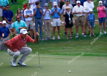 Stock Picture of Steve Stricker lines up his putt on the 18th hole during the final round of the Regions Tradition Champions Tour golf tournament, in Birmingham, Ala