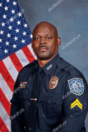 This undated photo from the Savannah Police Department shows Sgt. Kelvin Ansari, who died after being shot, while responding to an armed robbery call. Authorities say Ansari, 50, was helping investigate a robbery outside a barber shop when the suspected robber stepped out of a vehicle and shot him. The suspect, 49-year-old Edward Fuller Jr., was also fatally shot. A second police officer survived after being shot in the leg. Photo from the Savannah Police Department