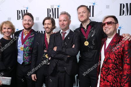Stock Photo of Trudie Styler, Imagine Dragons, Dan Reynolds, Ben McKee, Daniel Platzman, Daniel Sermon and Sting