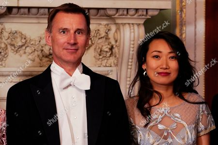 Britain's Foreign Secretary Jeremy Hunt (L) and Lucia Hunt (R) arrive at the Lord Mayor's Easter Banquet at Mansion House, Central London, Britain, 13 May 2019.