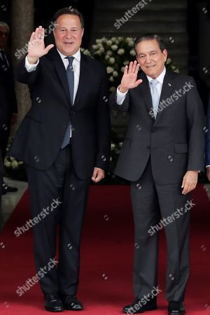 Panama's President Juan Carlos Varela (L) greets with the elect President Laurentino Cortizo (R) after a meeting of command handover at the Presidential Palace, in Panama City, Panama, 13 May 2019