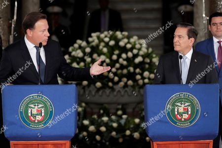 Panama's President Juan Carlos Varela (L) speaks in a press conference with the elect President Laurentino Cortizo (R) after a meeting of command handover at the Presidential Palace, in Panama City, Panama, 13 May 2019