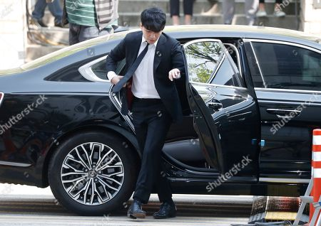South Korean singer-songwriter Lee Seung-hyun, also known by his stage name, Seungri, who is a member of group Big Bang, arrives at the Seoul District Court in Seoul, South Korea, 14 May 2019. Lee Seung-hyun attended a hearing on charges that he embezzled money from a Seoul night club embroiled in a drug and sex scandal.