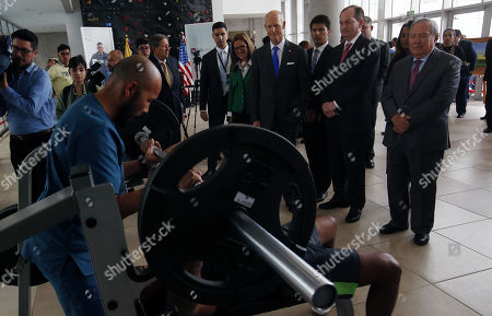 US Senator Rick Scott (4-R), the US Secretary of Labor Alexander Acosta (2-R) and Colombian Defense Minister Guillermo Botero (R) watch training exercise during a visit to the Center for Inclusive Rehabilitation (CRI), where sport and employment inclusion are extended to members of the Colombian armed forces wounded in combat, in Bogota Colombia, 13 May 2019. At least eight people have been killed in Colombia furing 2019 by anti-personnel mines, including six soldiers and one police officer according to Colombian Defense Minister Guillermo Botero.