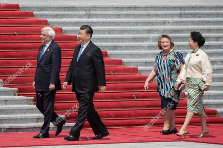 (L-R) Greek President Prokopis Pavlopoulos, Chinese President Xi Jinping, the Greek President's wife Vlassia Pavlopoulou-Peltsemi and China's President's wife Peng Liyuan walk during a welcome ceremony at the Great Hall of the People in Beijing, China, 14 May 2019.