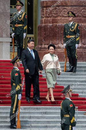 Chinese President Xi Jinping (C-L) and his wife Peng Liyuan (C-R) walk during a welcome ceremony for Greek President Prokopis Pavlopoulos (not pictured) at the Great Hall of the People in Beijing, China, 14 May 2019.