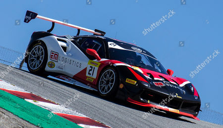 Monterey CA, U.S.A. #21 Danny Baker of new country competizion coming into the Corkscrew during the Ferrari Challenge Race 1 P/P- AM at Weathertech Raceway Laguna Seca Monterey CA Thurman James / CSM
