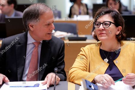 Italian Foreign Minister Enzo Moavero Milanesi (L) and Italian Defense Minister Elisabetta Trenta (R) during an European Foreign and Defense ministers council meeting in Brussels, Belgium, 14 May 2019. The agenda of the Foreign Affairs Council defence meeting includes talks on the Sahel and the NATO cooperation.