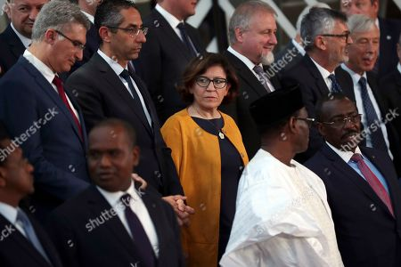 Italy's Defense Minister Elisabetta Trenta, center, stands along with ministers for a group photo after an EU Foreign and Defense Ministers meeting with their counterparts of the G5 Sahel countries at the European Council headquarters in Brussels